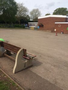 image of school playground with old tarmac surface