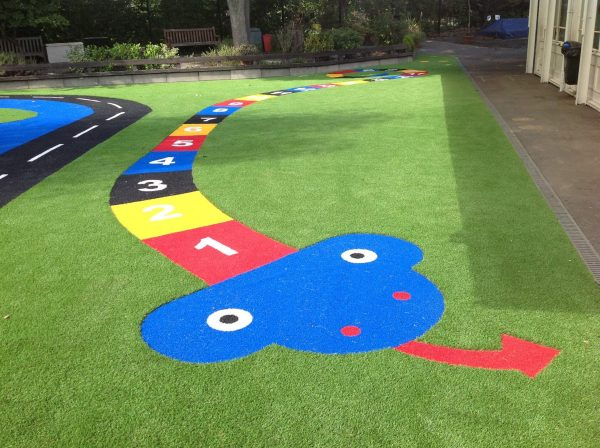 playground surfacing with number shapes for children to learn
