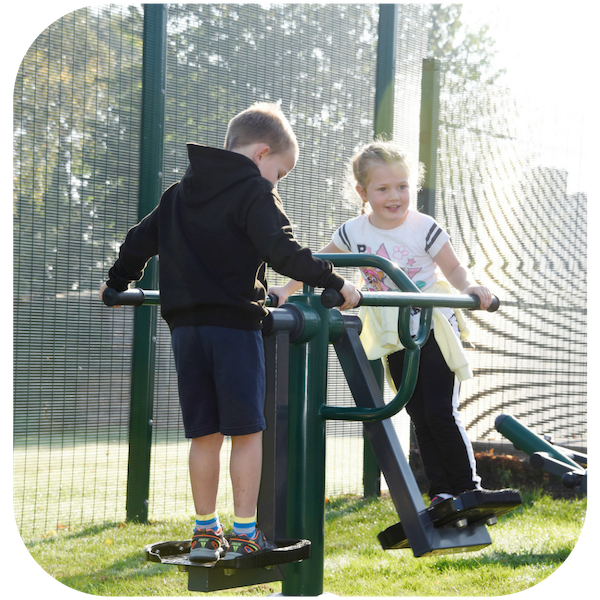 image of a primary school pupil using an item of outdoor gym equipment