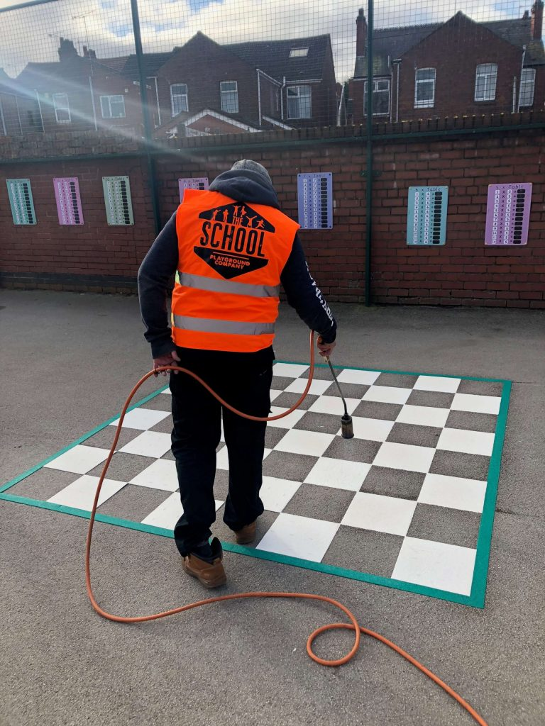 image of the school playground company installing a play marking in Coventry