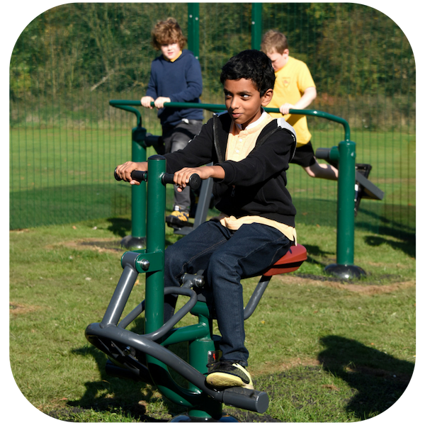 image of primary school children on outdoor gym equipment