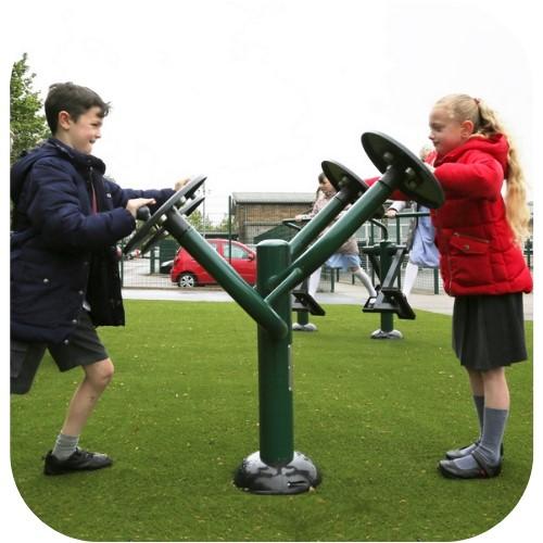 image of school children on outdoor fitness equipment