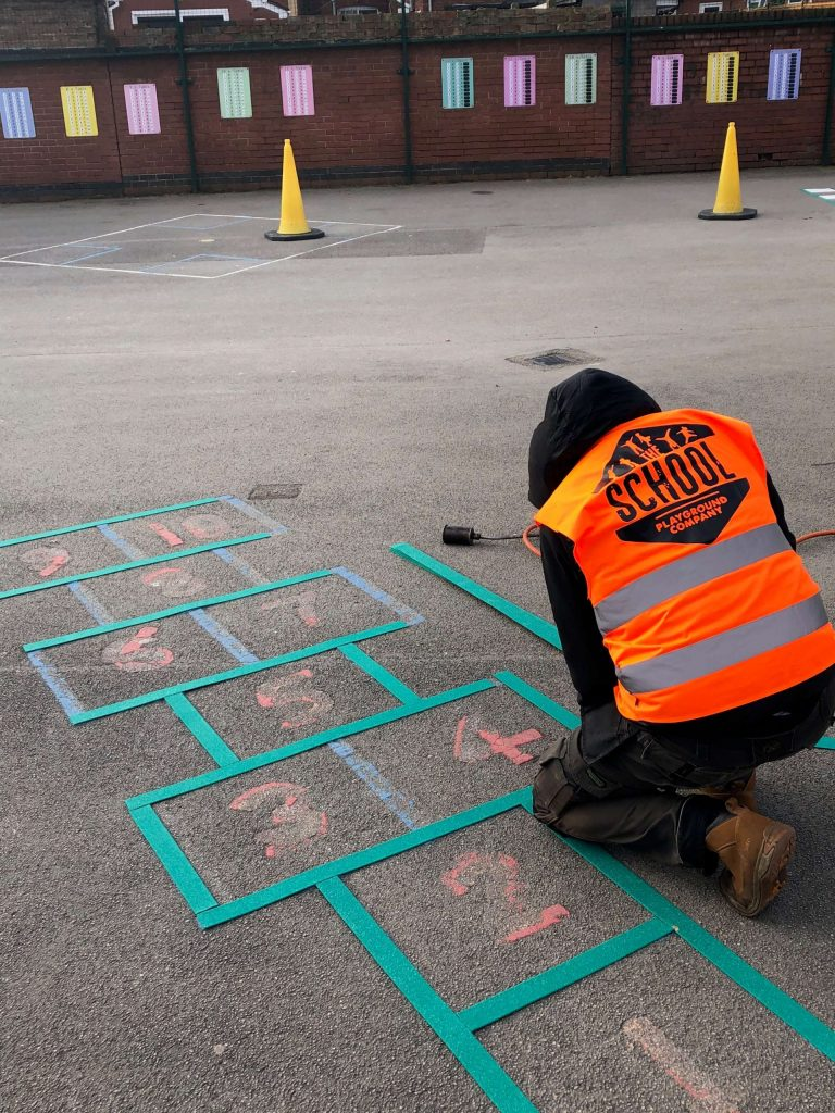 image of a repair of a playground marking