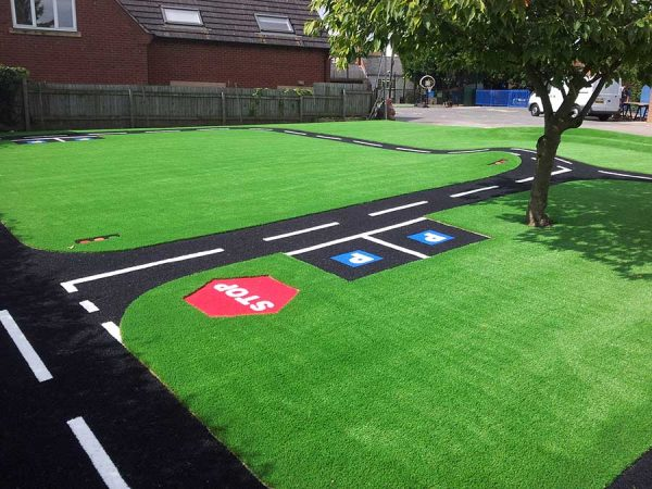 artificial grass with roadway design installed in a nursery