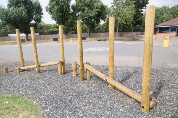 wooden trim trail item balance beams installed onto rubber mulch surface