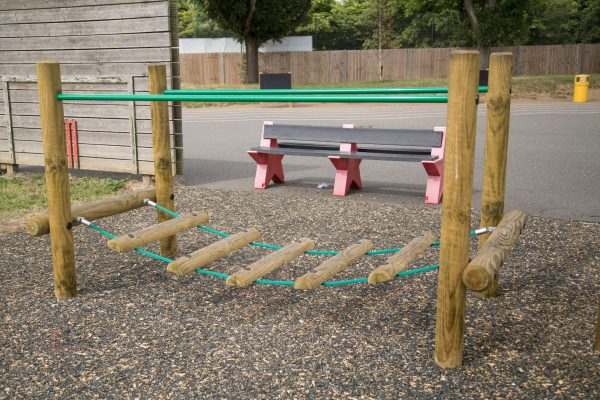 image of a wobble bridge with eco mulch surface in a primary school
