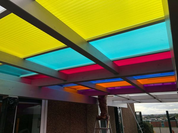 image of a colourful canopy roof in a school
